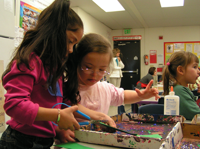 Students interacting at activity table