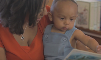 Mother and infant son reading a book