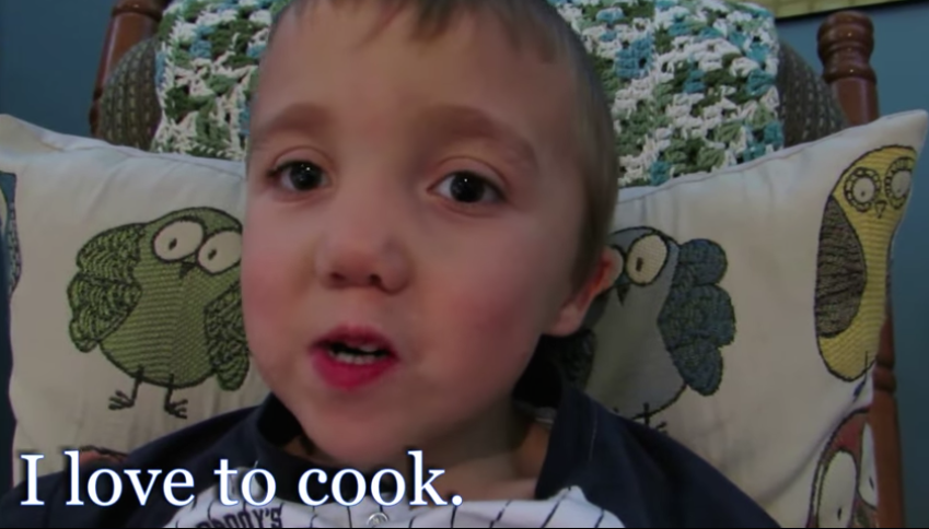 Grant speaking to the camera with a caption that reads 'I love to cook'