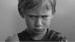 Close up of a boy making an upset face