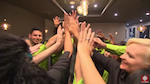 Restaurant staff members doing a group high five
