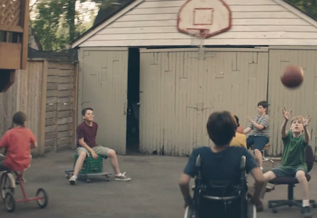 Kids using tricylces, chairs and wheelchair to play basketball
