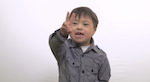 A boy with down syndrome talking to the camera about his friends