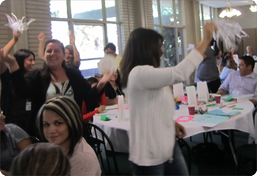 Group of adults cheering during a Teaching Pyramid activity