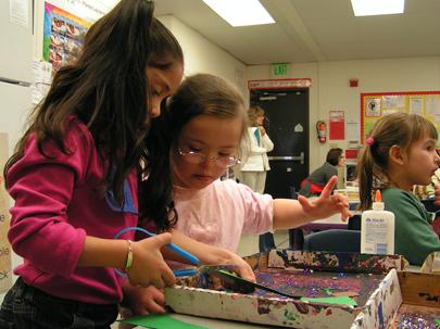 Students interacting at activity table