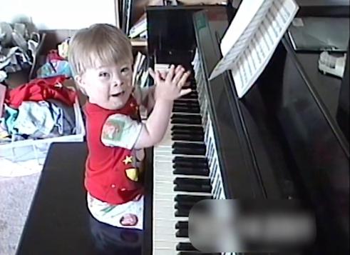 Young Brandon playing piano