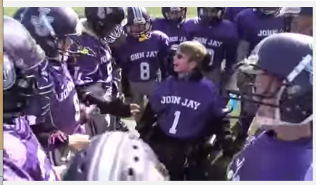 Youth football team cheering with Bryan