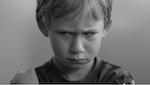 Close up of a boy making an upset face