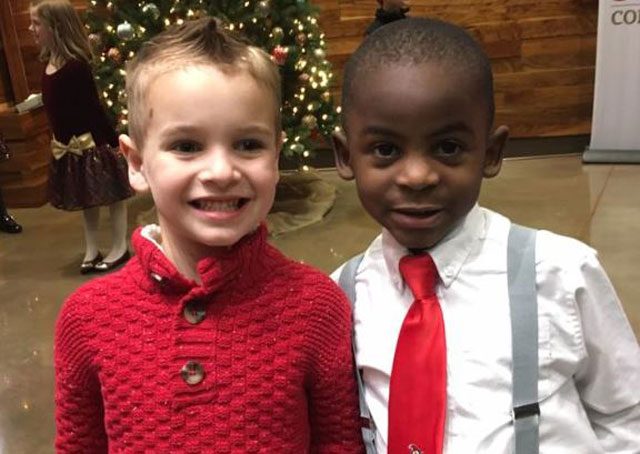 Two children with similar haircuts