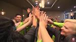Restaurant staff members doing a group high five