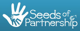 Three overlapping hands with the words Seeds of Partnership