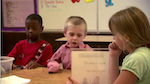 Three students engaged at a table activity
