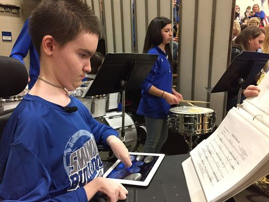 Ethan Och playing drums on an iPad