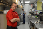 Tim Harris standing in his kitchen