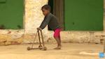 A child using a homemade wooden walker